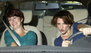two women on a road trip inside a car